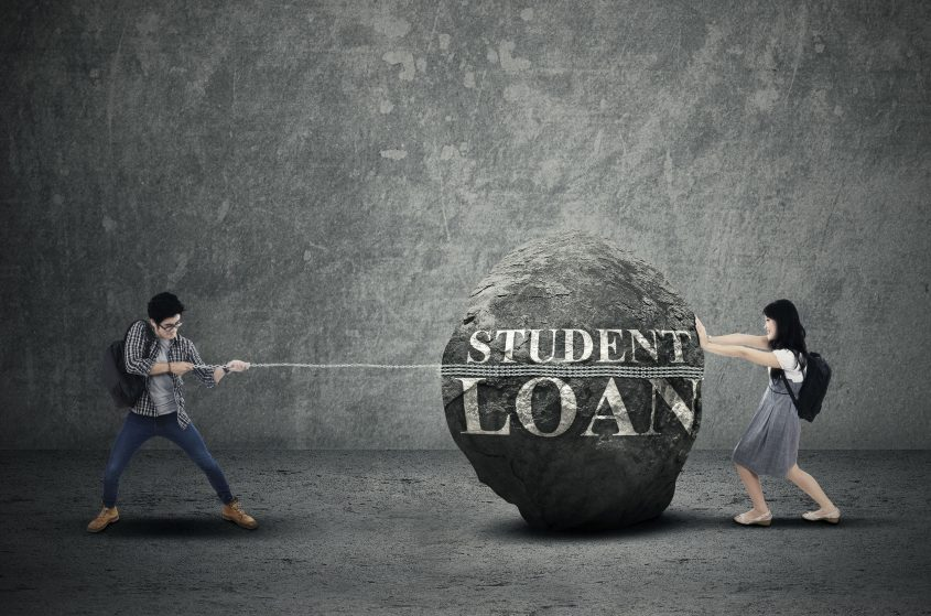 Expensive student loans concept with students pulling and pushing heavy bankruptcy stone.