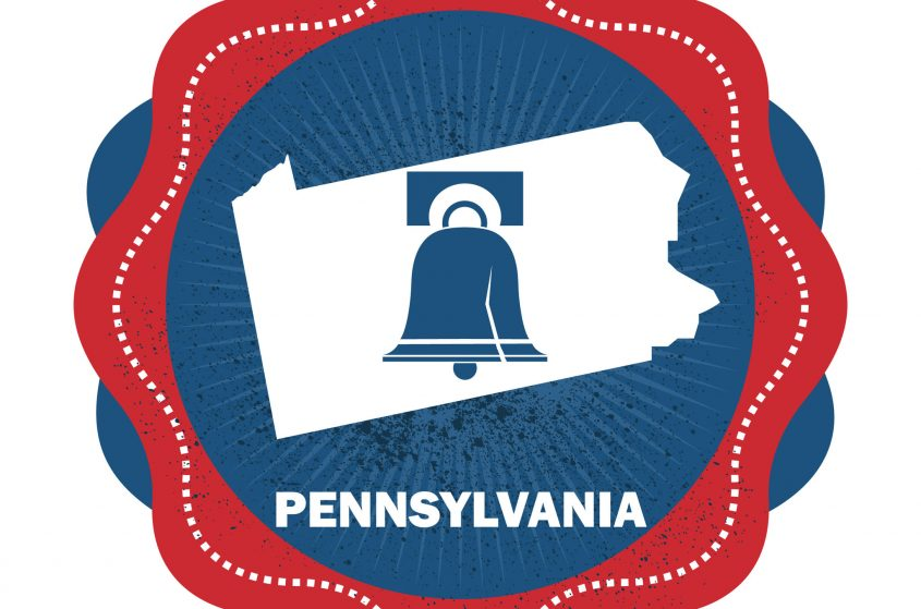 The liberty bell, the outline of the state, and the word Pennsylvania.