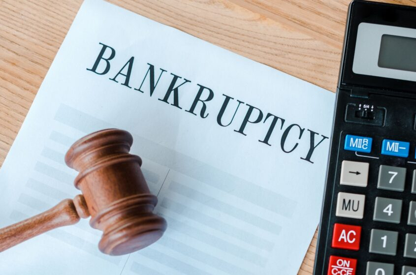 bankruptcy contract, gavel, and a calculator